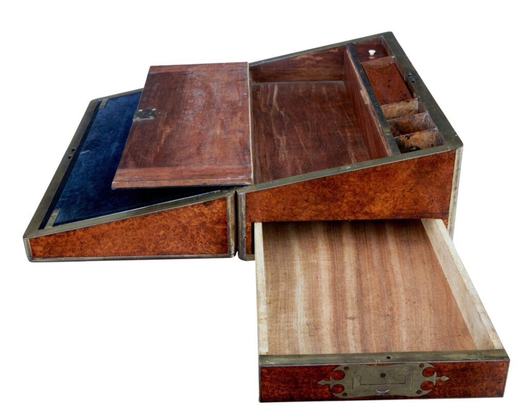 Image of an old unfolded lap desk with several compartments and writing surfaces, primarily made of wood. The object shows signs of age and use.